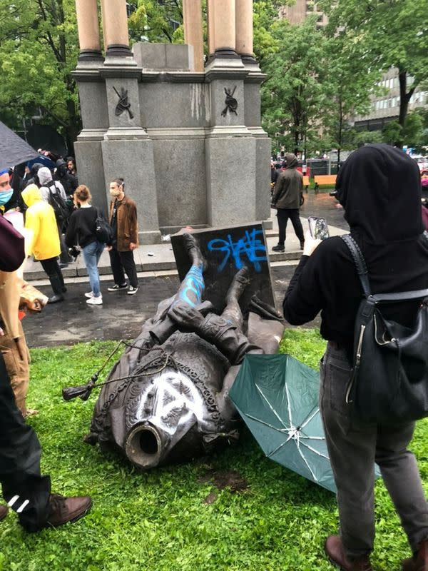 Statue of Canada's first prime minister toppled by protesters demanding police defunding
