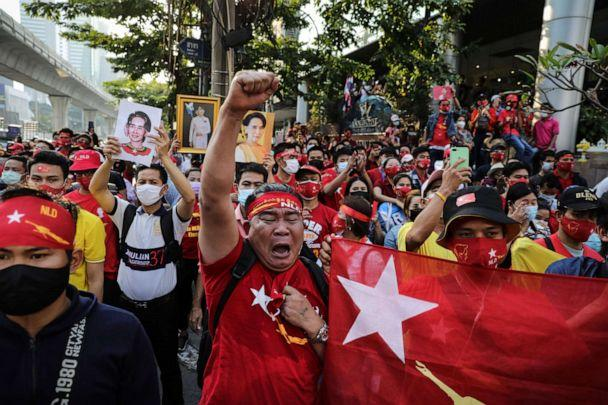 PHOTO: People hold up images of Myanmar's de-facto leader, Aung San Suu Kyi, while shouting at a protest outside the country's embassy in Bangkok, Thailand, on Feb. 01, 2021 in Bangkok, Thailand. (Lauren Decicca/Getty Images)