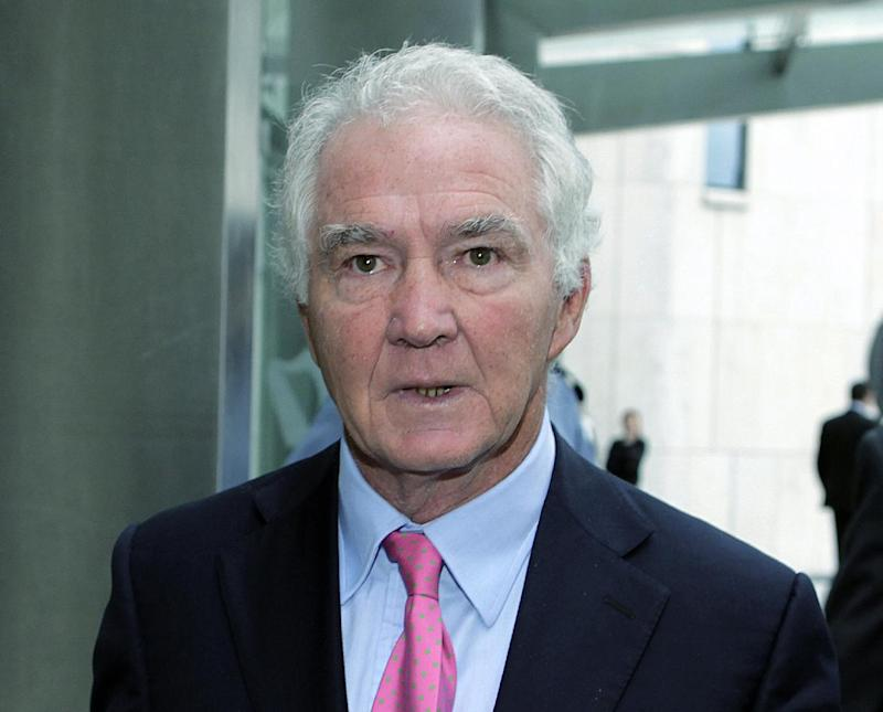 FILE- Former Anglo Irish Bank chief Sean FitzPatrick in this file photo dated Oct. 8, 2012.    The 64-year old former chief of Ireland's collapsed Anglo Irish Bank, FitzPatrick, has been arraigned Friday Dec. 21, 2012, in Dublin, Ireland,  on 12 new fraud charges of misleading auditors and shareholders over the euro 140 million (US dlrs 180 million) the bank granted him in personal loans. (AP Photo / Julien Behal, PA, FILE) UNITED KINGDOM OUT - NO SALES - NO ARCHIVES
