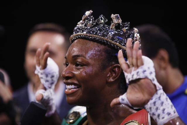 Claressa Shields poses for photographs after defeating Ivana Habazin in their 154-pound title boxing bout in Atlantic City, N.J., Friday, Jan. 10, 2020. (AP Photo/Matt Rourke)