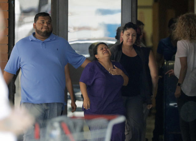 <p>People react as they leave the family unification center at the Alamo Gym, following a shooting at Santa Fe High School Friday, May 18, 2018, in Santa Fe, Texas. (Photo: David J. Phillip/AP) </p>