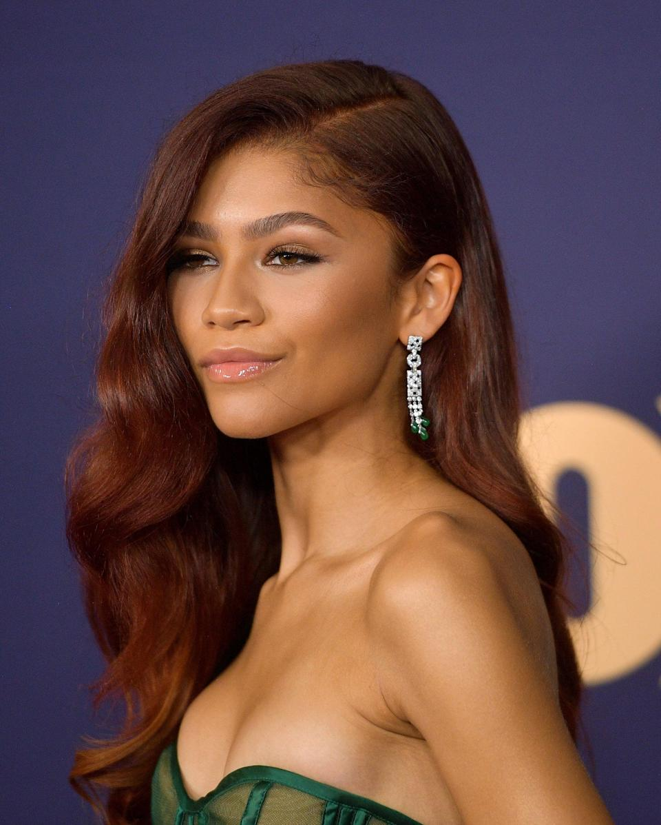 "<p>With her romantic waves, deep side part, and new reddish hue, it was impossible to ignore <a href=""https://www.popsugar.com/celebrity/zendaya-at-the-emmys-2019-46656009"" class=""link rapid-noclick-resp"" rel=""nofollow noopener"" target=""_blank"" data-ylk=""slk:Zendaya's hair at the Emmy Awards in 2019"">Zendaya's hair at the Emmy Awards in 2019</a>. </p>"