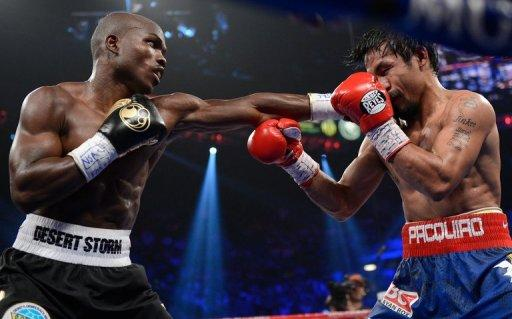 Timothy Bradley (L) lands a punch to the face of Manny Pacquiao during their WBO welterweight title fight at MGM Grand Garden Arena on June 9. Bradley ended Pacquiao's 15-fight winning streak with a split decision victory, seizing the Filipino icon's WBO welterweight title