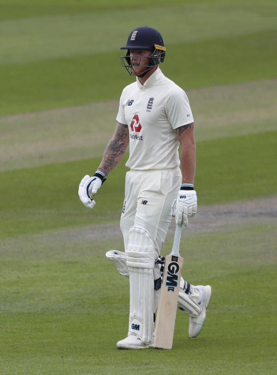 England's Ben Stokes walks off the field after being dismissed by Pakistan's Yasir Shah during the fourth day of the first cricket Test match between England and Pakistan at Old Trafford in Manchester, England, Saturday, Aug. 8, 2020. (Lee Smith/Pool via AP)