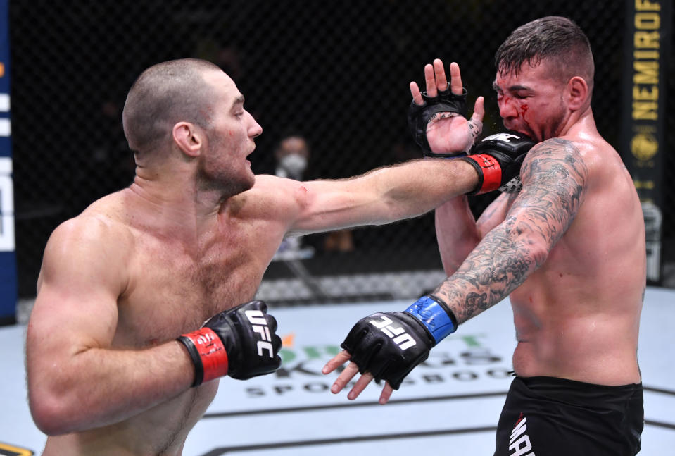 LAS VEGAS, NEVADA - OCTOBER 31: (L-R) Sean Strickland punches Jack Marshman of Wales in a middleweight bout during the UFC Fight Night event at UFC APEX on October 31, 2020 in Las Vegas, Nevada. (Photo by Jeff Bottari/Zuffa LLC)