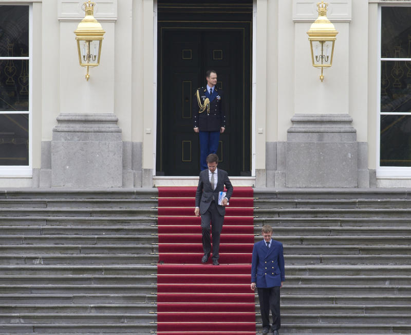 Dutch prime minister Mark Rutte,  leaves royal palace Huis ten Bosch after meeting with Dutch Queen Beatrix in The Hague, Netherlands, Monday April 23, 2012. Rutte was reported to have handed in his resignation to the Queen after seven weeks of talks to hammer out an austerity package aimed at bringing the Dutch budget deficit back within European Union limits collapsed Saturday. (AP Photo/Peter Dejong)