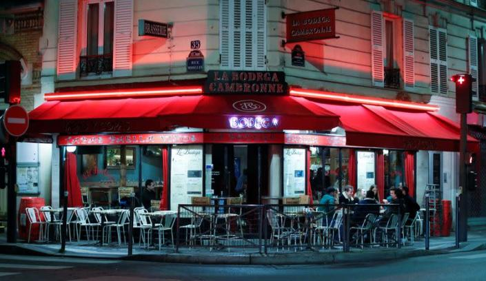 People sit in a outside restaurant, as France's Prime Minister announced to close most all non-indispensable locations, notably cafes, restaurants, cinemas, nightclubs and shops from midnight on Saturday, in Paris