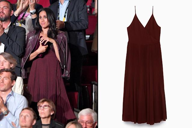 "<p>In September, Markle wore another monochromatic look, pairing this burgundy pleated dress by Aritzia with a matching moto jacket at the Invictus Games, which she attended with Prince Harry. Fortunately, this dress has since been restocked and you can place your order for one, though it won't ship until the end of February. (Photo: Getty Images; courtesy of Aritzia)<br>Shop: Aritzia Beaune Dress, $185, <a href=""https://us.aritzia.com/product/beaune-dress/61870.html?dwvar_61870_color=2346"" rel=""nofollow noopener"" target=""_blank"" data-ylk=""slk:aritzia.com"" class=""link rapid-noclick-resp"">aritzia.com</a> </p>"