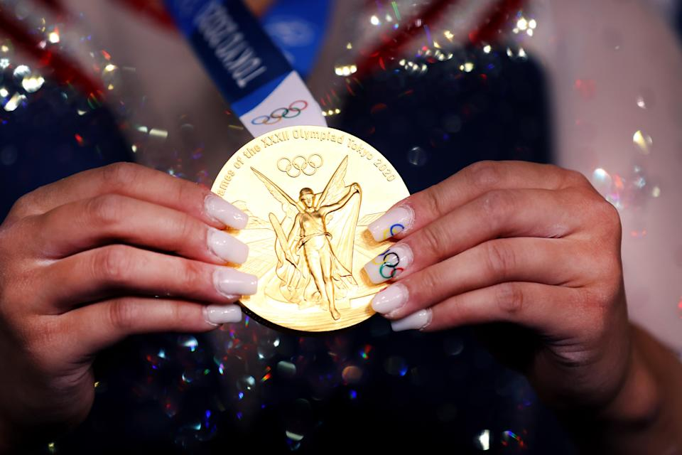 Sunisa Lee shows off gold medal and Olympic-inspired nails (Getty Images)