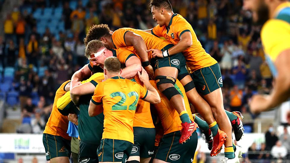 The Wallabies were elated after Quade Cooper's penalty goal earned them a 28-26 win over South Africa. (Photo by Chris Hyde/Getty Images)