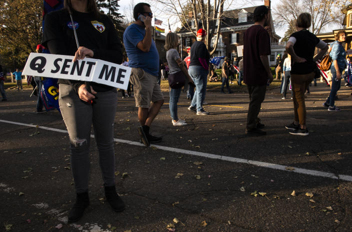 A woman holds a sign referencing the QAnon conspiracy as supporters of President Donald Trump gather outside the Governor's Mansion in St Paul, Minnesota on November 7, 2020. (Stephen Maturen/Getty Images)