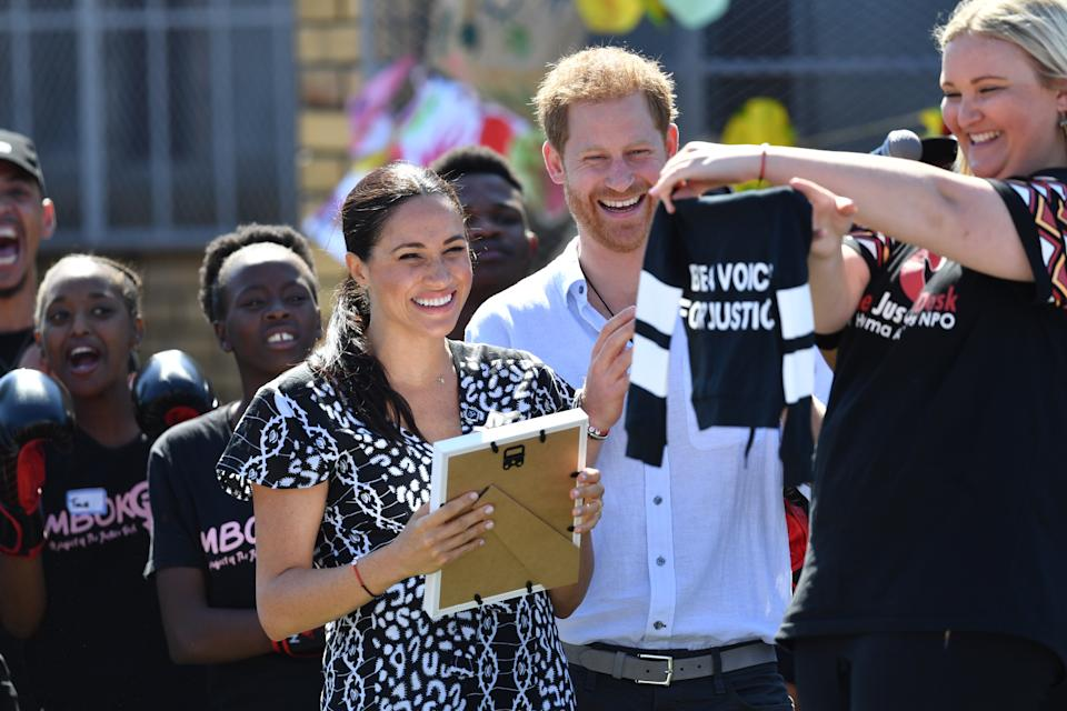 The Duke and Duchess of Sussex are presented with a gift for son Archie as they visit the Nyanga Township in Cape Town, South Africa, during the first day of their tour of Africa. (Photo by Dominic Lipinski/PA Images via Getty Images)