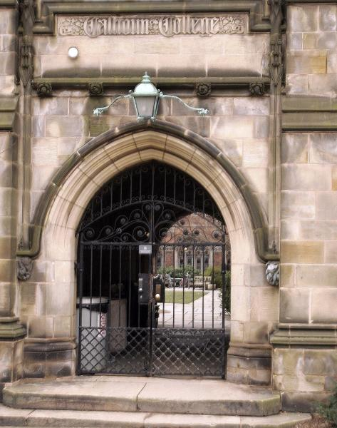 FILE - This Friday, Feb. 2, 2007 file photo shows a rear gate at Calhoun College, one of Yale's 12 residential colleges for undergraduates. On Saturday, Feb. 11, 2017, Yale University said it is renaming Calhoun College after Grace Hooper, a trailblazing computer scientist, a mathematician who earned Yale degrees in the 1930s, invented a pioneering computer programming language and became a Navy rear admiral. (AP Photo/Bob Child)