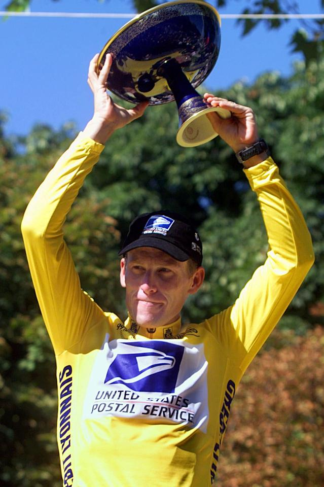 FILE - In this July 25, 1999 file photo, Tour de France winner Lance Armstrong of the U.S. holds up the trophy on the podium after 20th and final stage of the Tour de France cycling race between Arpajon and Paris. Tyler Hamilton, a former teammate of Armstrong, has told CBS News that he used performance-enhancing drugs with the seven-time Tour de France winner to cheat in cycling races, including the tour. Armstrong has steadfastly denied doping and has never failed a drug test.