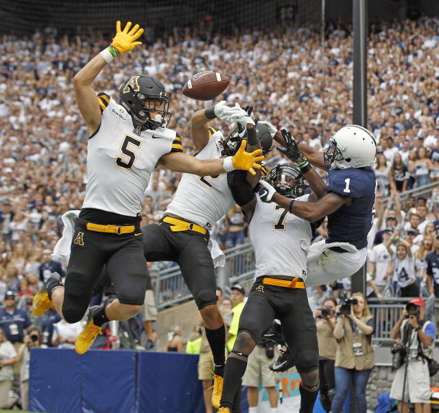 Appalachian State defenders Thomas Hennigan (5), Corey Sutton (2) and Josh Thomas (7), break up a pass intended for Penn State's KJ Hamler in the end zone last week. (AP)