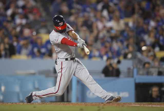Washington Nationals' Michael Taylor hits an RBI single during the sixth inning of a baseball game against the Los Angeles Dodgers, Friday, April 20, 2018, in Los Angeles. (AP Photo/Jae C. Hong)