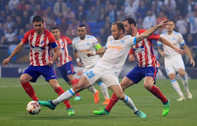 Soccer Football - Europa League Final - Olympique de Marseille vs Atletico Madrid - Groupama Stadium, Lyon, France - May 16, 2018 Marseille's Valere Germain in action with Atletico Madrid's Diego Godin and Gabi REUTERS/Gonzalo Fuentes