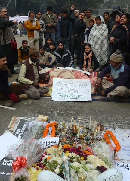 Indian residents gather to pray for a gang-rape victim during a silent protest in New Delhi on January 1, 2013. Police arrested a man on Tuesday as he tried to plant a crude bomb near the home of one of the suspects in the New Delhi gang-rape case as a backlash against widespread sex crimes gathered steam