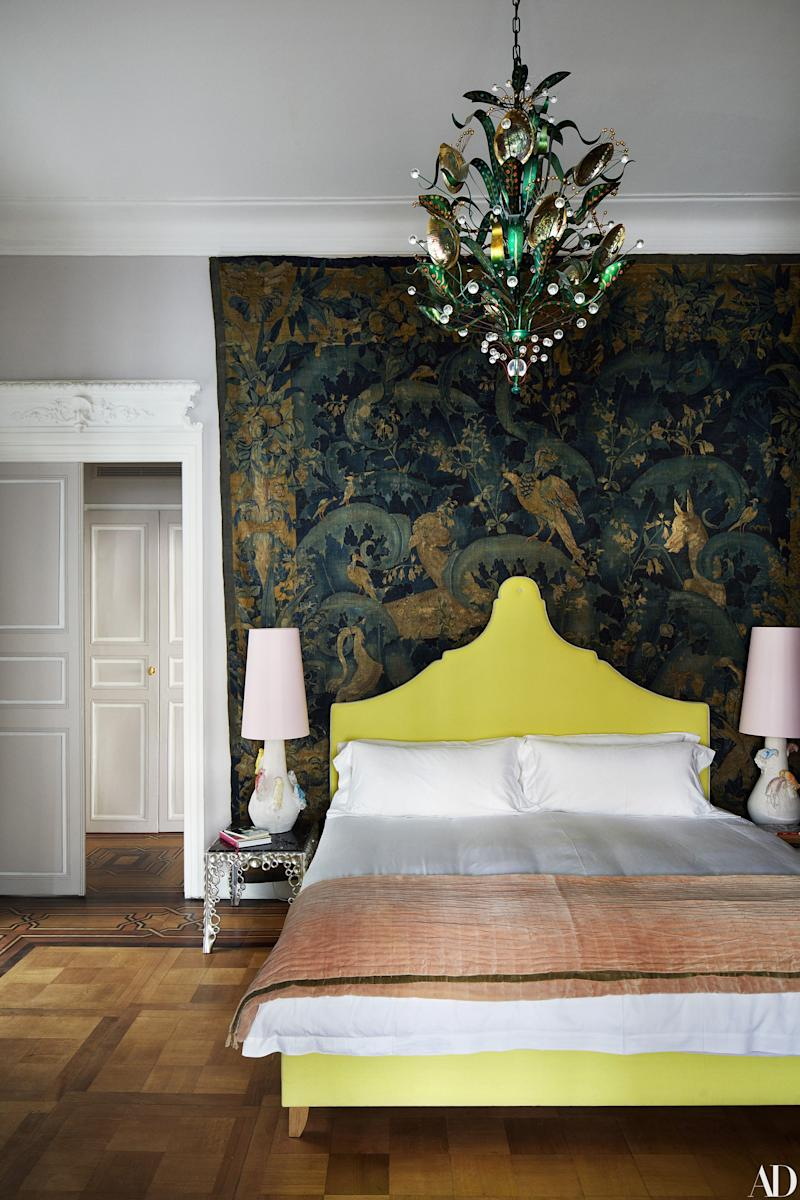 A 16th-century tapestry hangs on a bedroom wall. Tony Duquette abalone chandelier; side tables by Othoniel; lamps by Creten.