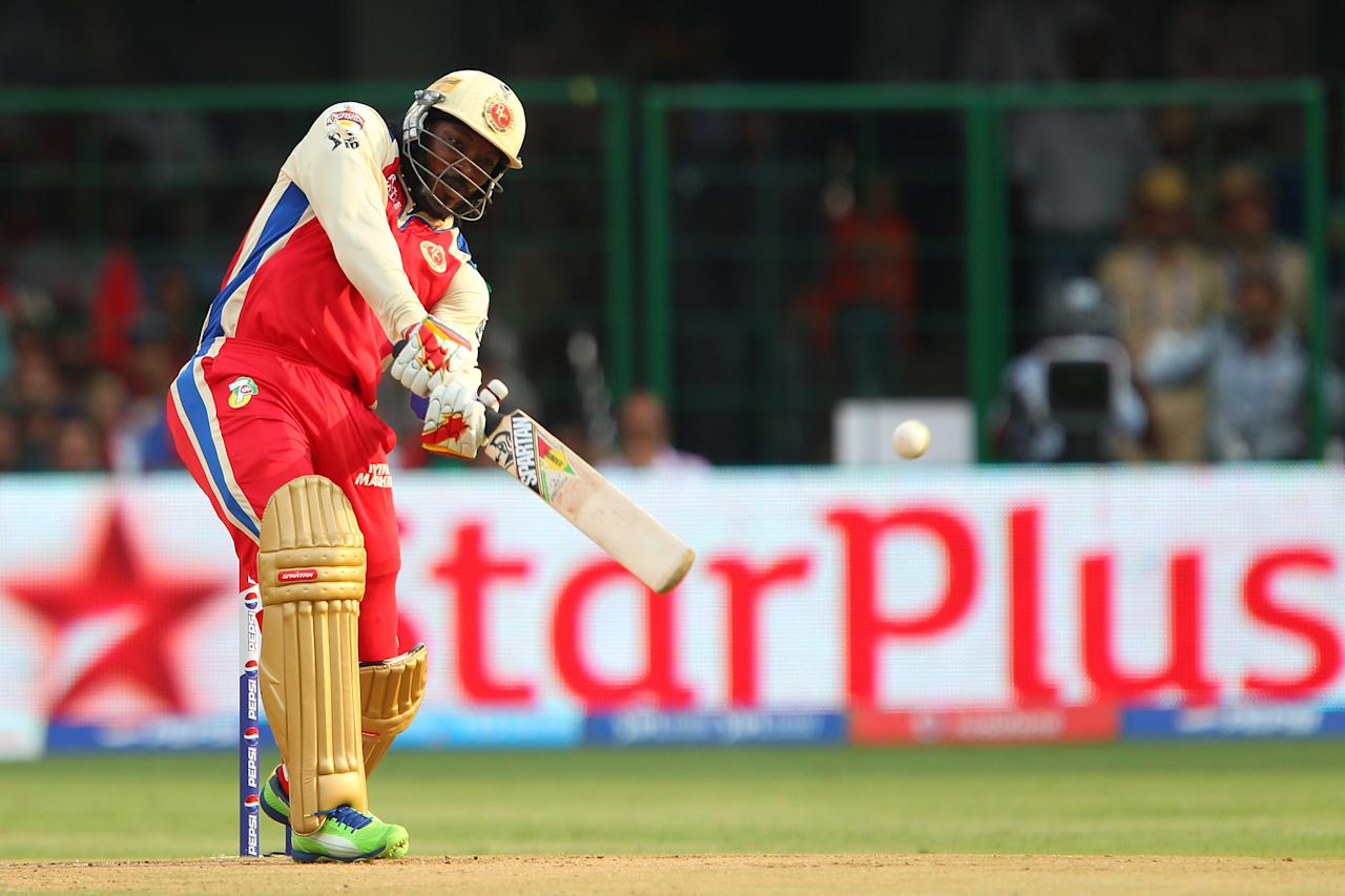 Chris Gayle launches a Mitchell Marsh delivery for six during match 31 of the Pepsi Indian Premier League between The Royal Challengers Bangalore and The Pune Warriors India held at the M. Chinnaswamy Stadium, Bengaluru  on the 23rd April 2013..Photo by Ron Gaunt-IPL-SPORTZPICS ..Use of this image is subject to the terms and conditions as outlined by the BCCI. These terms can be found by following this link:..https://ec.yimg.com/ec?url=http%3a%2f%2fwww.sportzpics.co.za%2fimage%2fI0000SoRagM2cIEc&t=1493123145&sig=vXLFBs5i_IoXGD8TIMi4pA--~C