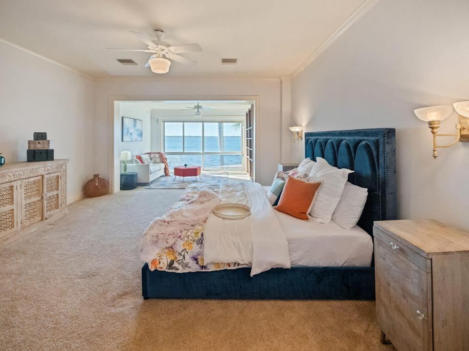 <p>The home features a guest wing with five en-suite bedrooms, a great room, and a bar.</p>