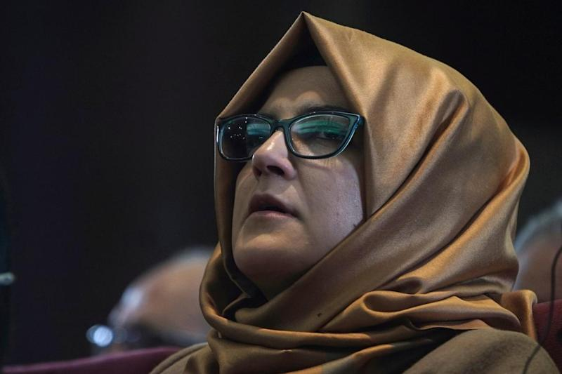 Hatice Cengiz, Turkish finance of slain journalist Jamal Khashoggi, listens during an event organized to mark the 40th day of the death of the Saudi writer, in Istanbul (AP)