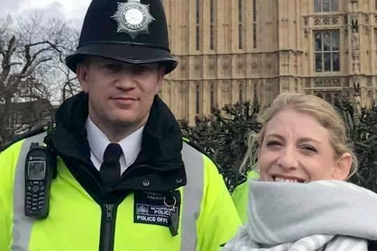 PC Keith Palmer with US tourist Staci Martin shortly before the attack