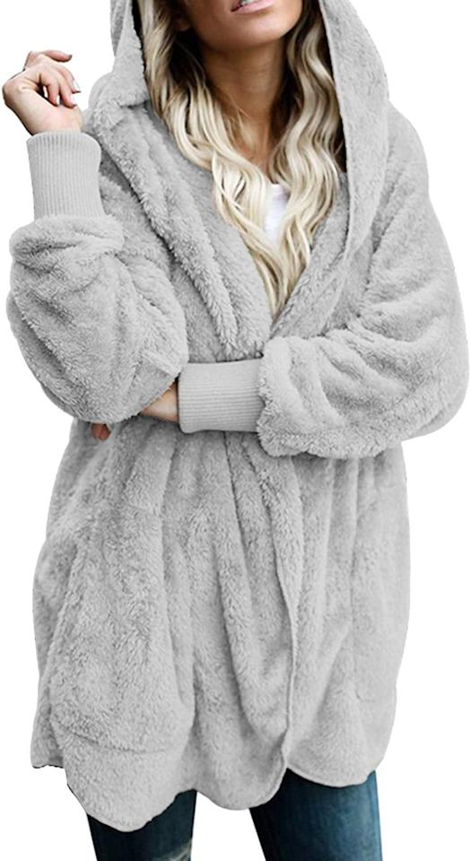"<p>We need this <a href=""https://www.popsugar.com/buy/Dokotoo-Fuzzy-Fleece-Open-Front-Hooded-Cardigan-497217?p_name=Dokotoo%20Fuzzy%20Fleece%20Open-Front%20Hooded%20Cardigan&retailer=amazon.com&pid=497217&price=36&evar1=savvy%3Auk&evar9=46707523&evar98=https%3A%2F%2Fwww.popsugar.com%2Fsmart-living%2Fphoto-gallery%2F46707523%2Fimage%2F46708967%2FDokotoo-Fuzzy-Fleece-Open-Front-Hooded-Cardigan&list1=shopping%2Cfall%2Cunder%20%24100%2Caffordable%20shopping&prop13=api&pdata=1"" rel=""nofollow"" data-shoppable-link=""1"" target=""_blank"" class=""ga-track"" data-ga-category=""Related"" data-ga-label=""https://www.amazon.com/Dokotoo-Oversized-Hoodies-Cardigan-Sweater/dp/B076M3MW9F/ref=sr_1_1_sspa?keywords=fuzzy%2Bsweaters%2Bfor%2Bwomen&amp;qid=1570037582&amp;sr=8-1-spons&amp;smid=A1CNZD9HE67P6B&amp;spLa=ZW5jcnlwdGVkUXVhbGlmaWVyPUFNV0VBTExUSUhMTlYmZW5jcnlwdGVkSWQ9QTA2MjA4NDMxMDhDUUxIV1hKQ0xJJmVuY3J5cHRlZEFkSWQ9QTAyMzc4MTAxU0RCTkNUMEpQTUpYJndpZGdldE5hbWU9c3BfYXRmJmFjdGlvbj1jbGlja1JlZGlyZWN0JmRvTm90TG9nQ2xpY2s9dHJ1ZQ&amp;th=1&amp;psc=1"" data-ga-action=""In-Line Links"">Dokotoo Fuzzy Fleece Open-Front Hooded Cardigan</a> ($36) now.</p>"