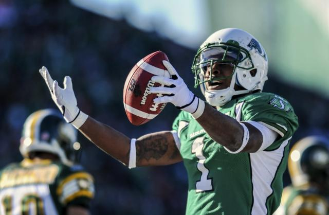 Saskatchewan Roughriders running back Kory Sheets celebrates after scoring a touchdown during the first half of their CFL football game against the Edmonton Eskimos in Regina, Saskatchewan October 12, 2013. REUTERS/Matt Smith (CANADA - Tags: SPORT FOOTBALL)