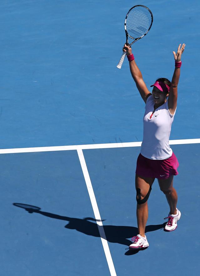 Li Na of China celebrates after defeating Eugenie Bouchard of Canada during their semifinal at the Australian Open tennis championship in Melbourne, Australia, Thursday, Jan. 23, 2014.(AP Photo/Eugene Hoshiko)