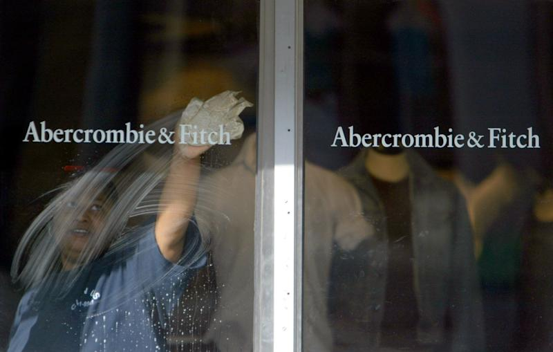 A window washer cleans the door of the Abercrombie and Fitch store in Manhattan' s South Street Seaport, Tuesday, May 17, 2005 in New York. Abercrombie & Fitch is expected to release earnings after the market close on Tueesday. (AP Photo/Mary Altaffer)