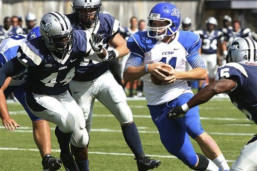Central Connecticut State quarterback Andrew Clements (11) runs under pressure from New Hampshire's Dab Ukwuani (44) and Daniel Rowe (45) in the second half of their NCAA college football game,Saturday, Sept. 15, 2012,in Durham, N.H. New hampshire won 43-10.(AP Photo/Cheryl Senter)