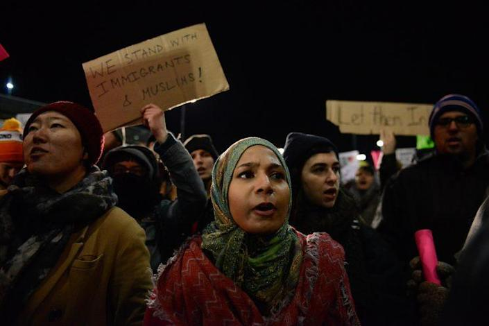 Protestors rally during a demonstration against the new immigration ban issued by President Donald Trump at John F. Kennedy International Airport on January 28, 2017 in New York City. (Photo: Stephanie Keith/Getty Images)