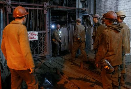 Miners wait to enter an elevator before descending into the Novovolynska-9 coal mine in Novovolynsk, Ukraine August 2, 2018. Picture taken August 2, 2018.  REUTERS/Valentyn Ogirenko