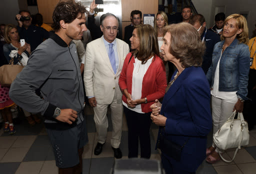 Rafael Nadal, of Spain, greets Queen Sofia of Spain after defeating Novak Djokovic, of Serbia, in the men's singles final of the 2013 U.S. Open tennis tournament, Monday, Sept. 9, 2013, in New York. (AP Photo/Andrew Gombert, Pool)
