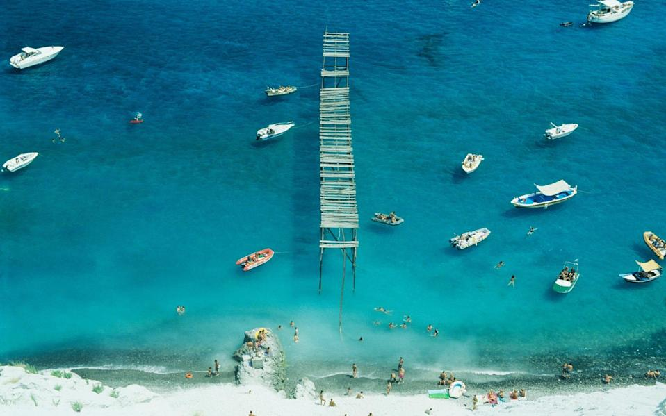 aerial shot of boats and people on beach - Vincenzo Lombardo/Getty Images