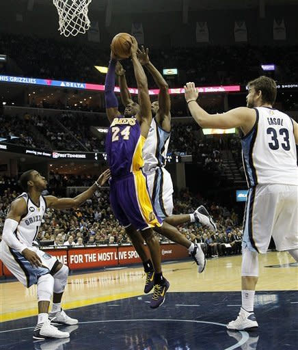 Los Angeles Lakers guard Kobe Bryant (24) is fouled by Memphis Grizzlies guard Tony Allen, back, while heading to the basket between Grizzlies' Marc Gasol (33) and Mike Conley (11) in the first half of an NBA basketball game on Friday, Nov. 23, 2012, in Memphis, Tenn. (AP Photo/Lance Murphey)