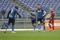 Inter Milan's Milan Skriniar, center right, celebrates after scoring his side's first goal during a Serie A soccer match between Roma and Inter Milan at Rome's Olympic stadium, Sunday, Jan. 10, 2021. (AP Photo/Gregorio Borgia)