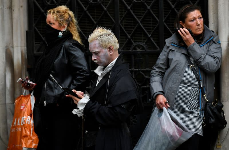 Supporters of actor Johnny Depp react after the verdict of the libel case of Depp with The Sun, outside of the High Court in London