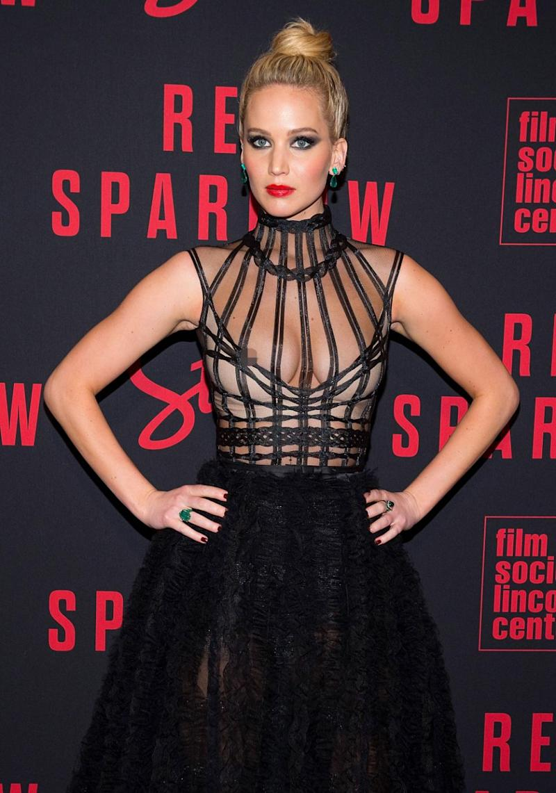 Her strappy black dress just moved a little too far down. Source: Getty
