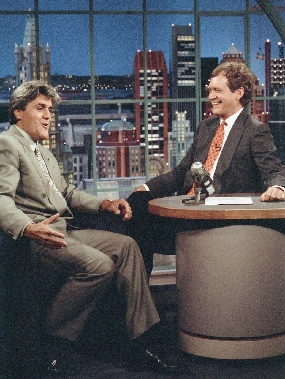 """<p>The <a href=""""https://people.com/tv/david-letterman-feud-jay-leno-a-new-biography-host-unhappiness"""" rel=""""nofollow noopener"""" target=""""_blank"""" data-ylk=""""slk:biggest feud in late-night history"""" class=""""link rapid-noclick-resp"""">biggest feud in late-night history</a> occurred when Johnny Carson announced he was leaving NBC's <em>The Tonight Show</em> in 1992. David Letterman — who hosted his own show on the same network — was widely expected to be Carson's replacement, but much to everyone's surprise, comedian Jay Leno ended up landing the coveted gig. Not soon after, David left NBC to host <em>The</em> <em>Late Show with David Letterma</em><em>n </em>on CBS instead — right opposite Leno's time-slot.</p>"""