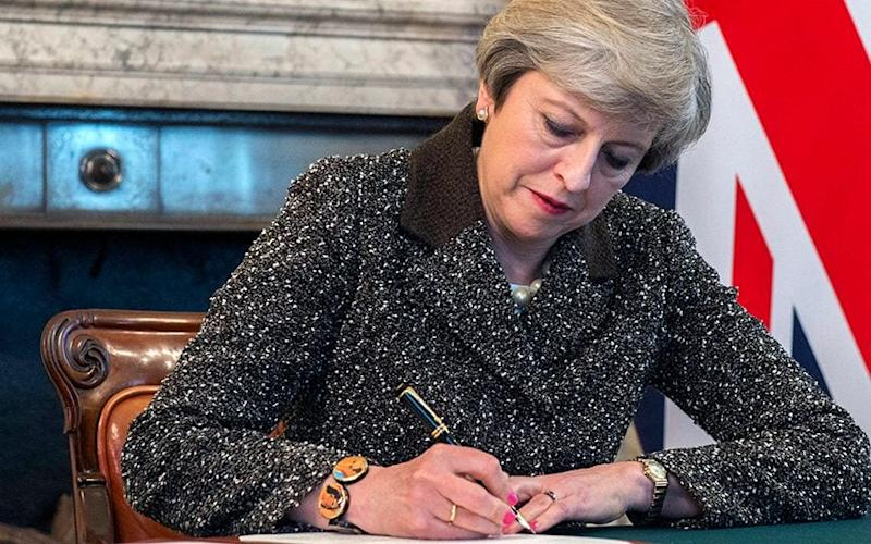 Prime Minister Theresa May signing a letter of notification to the President of the European Council setting out the United Kingdom's intention to withdraw from the European Union - JAY ALLEN