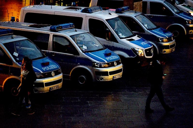 Police cars parked next to Cologne's main train station in western Germany on January 13, 2016, where New Year's Eve sexual assaults took place