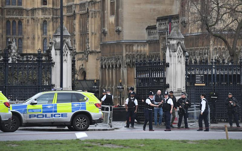 Police outside the Palace of Westminster shortly after the attack - Credit:  Victoria Jones/PA