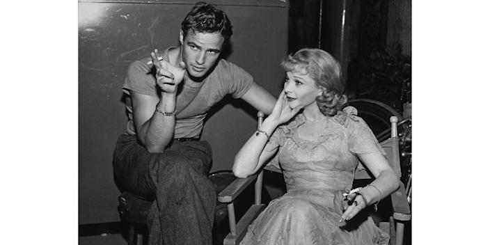 """<p>Costars Marlon Brando and Vivien Leigh chat during a break from filming <em>A Streetcar Named Desire</em>. Method actor Brando was nominated for an Oscar for his portrayal of Stanley Kowalski, but has said revealed he <a href=""""https://www.newyorker.com/magazine/2008/10/27/method-man"""" rel=""""nofollow noopener"""" target=""""_blank"""" data-ylk=""""slk:detested playing the character"""" class=""""link rapid-noclick-resp"""">detested playing the character</a>. </p>"""