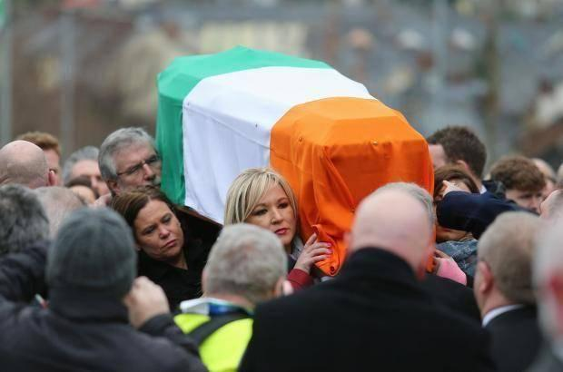 Mary Lou McDonald, Michelle O'Neill and Gerry Adams carry the coffin of Martin McGuinness