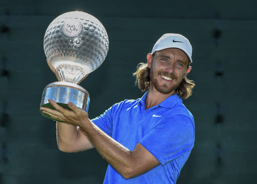 England's Tommy Fleetwood celebrates winning the the 39th edition of the Nedbank Golf Challenge, at Sun City, South Africa, Sunday, Nov. 17 2019. Fleetwood made three eagles and came from six shots behind going into the final round to win the Nedbank Golf Challenge in a playoff against Marcus Kinhult on Sunday. (AP Photo/Christiaan Kotze)