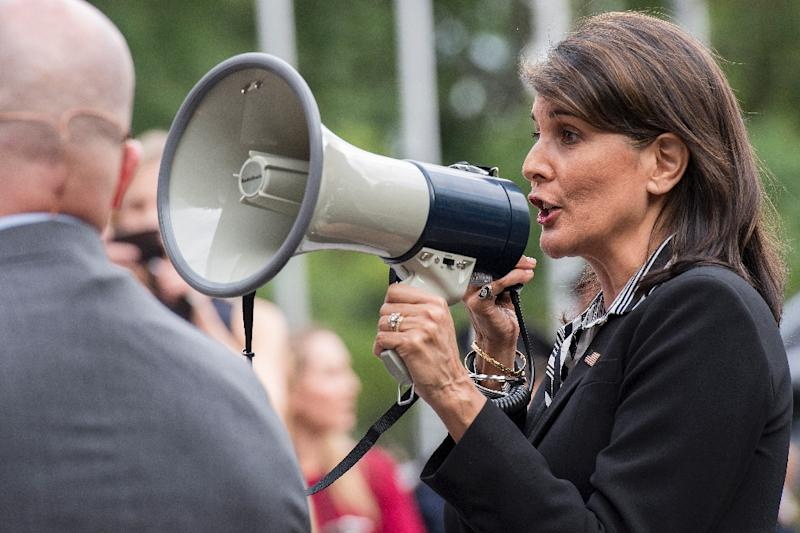 Nikki Haley took the highly unusual step for a senior diplomat of joining street protesters shouting from a megaphone that Venezuelan President Maduro should leave office