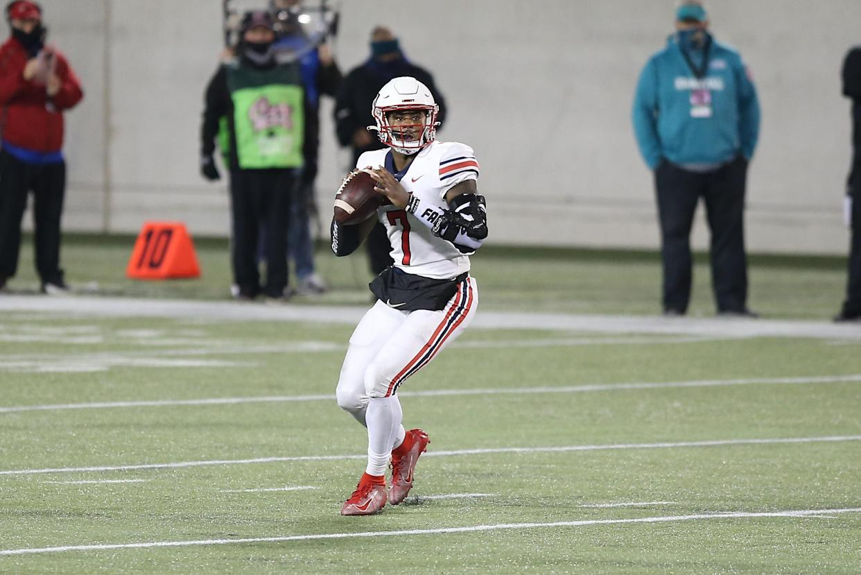 Liberty quarterback Malik Willis' ability to scramble and throw on the move make him a fascinating prospect. (Photo by David Rosenblum/Icon Sportswire via Getty Images)