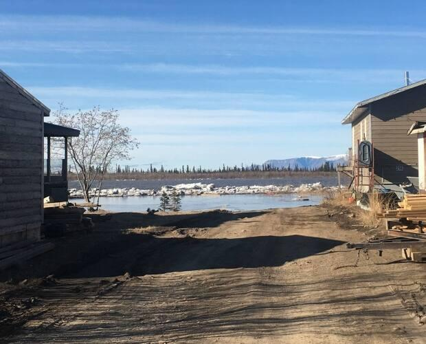 Water was drawing closer to some homes in the hamlet of Aklavik, N.W.T., on Sunday morning.